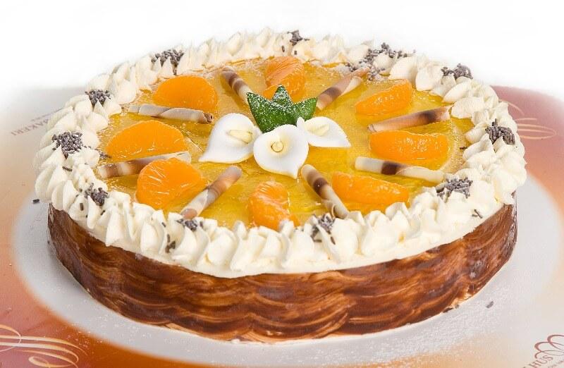 Melhus Bakeri - Ostekake med mango og pasjon